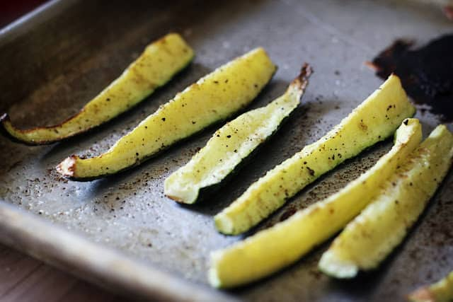 zucchini slices on sheet pan.