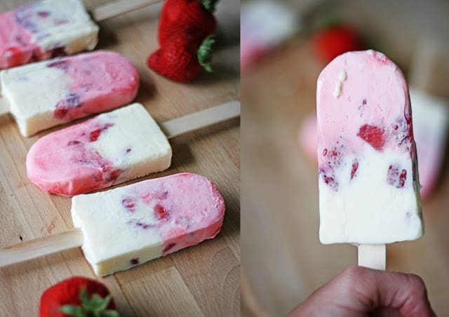 side by side images of creamy strawberry cheesecake popsicles laying on a wooden table and one being held in a person's hand.