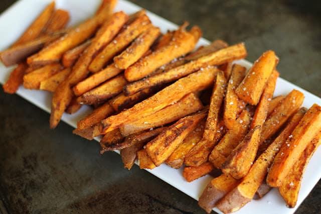 sweet potato fries on white tray.