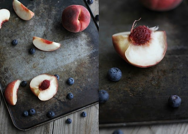 side by side images of blueberries and peaches on a baking sheet.