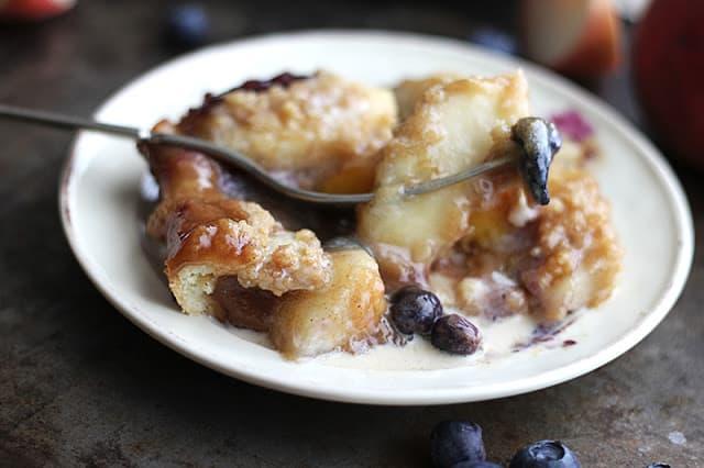 piece of blueberry peach cobbler crisp with fork.