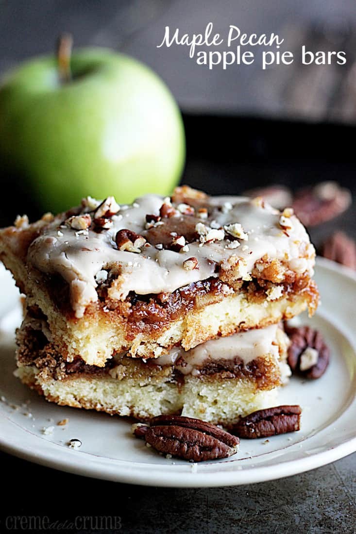 stacked maple pecan apple pie bars on a plate with a green apple faded in the background with the title written on the top right corner of the image.