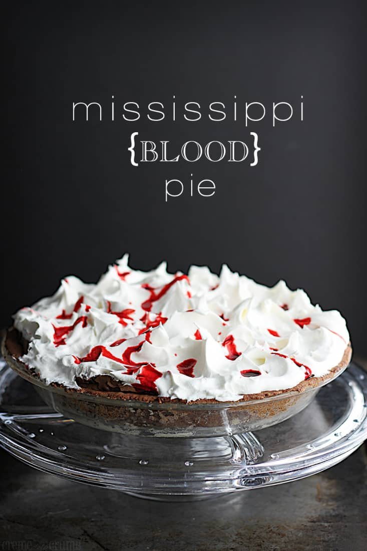 Mississippi blood pie on cake platter with the title on the top of the image.