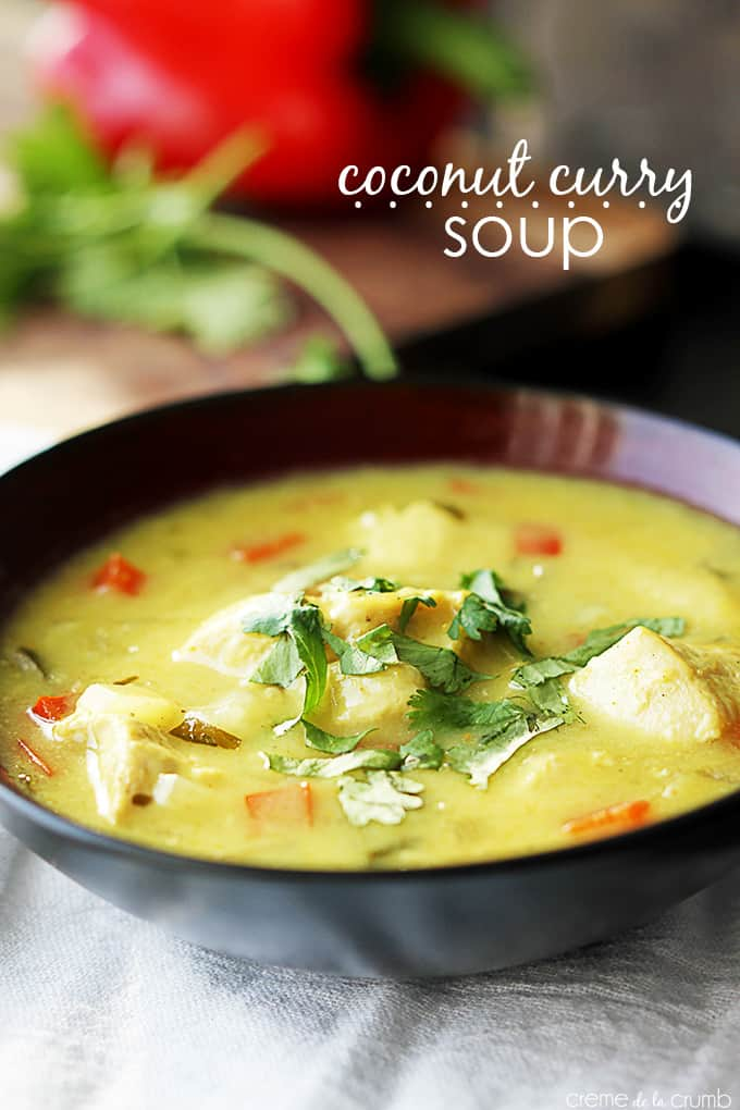 coconut curry soup in a bowl with the title of the recipe written on the top right of the image.