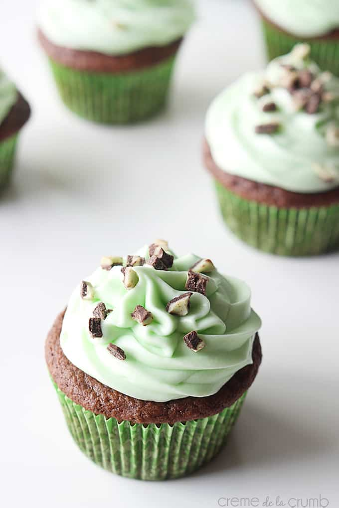 an Andes mint grasshopper cupcake with more cupcakes faded in the background.