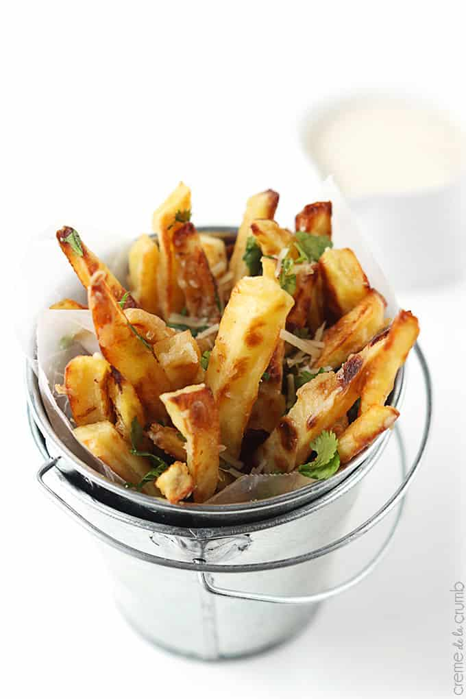 top view of garlic parmesan oven fries in a small metal bucket.