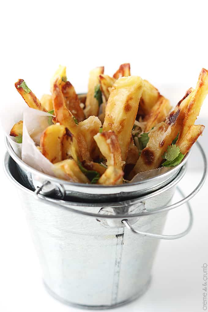 close up of garlic parmesan oven fries in a small metal bucket.