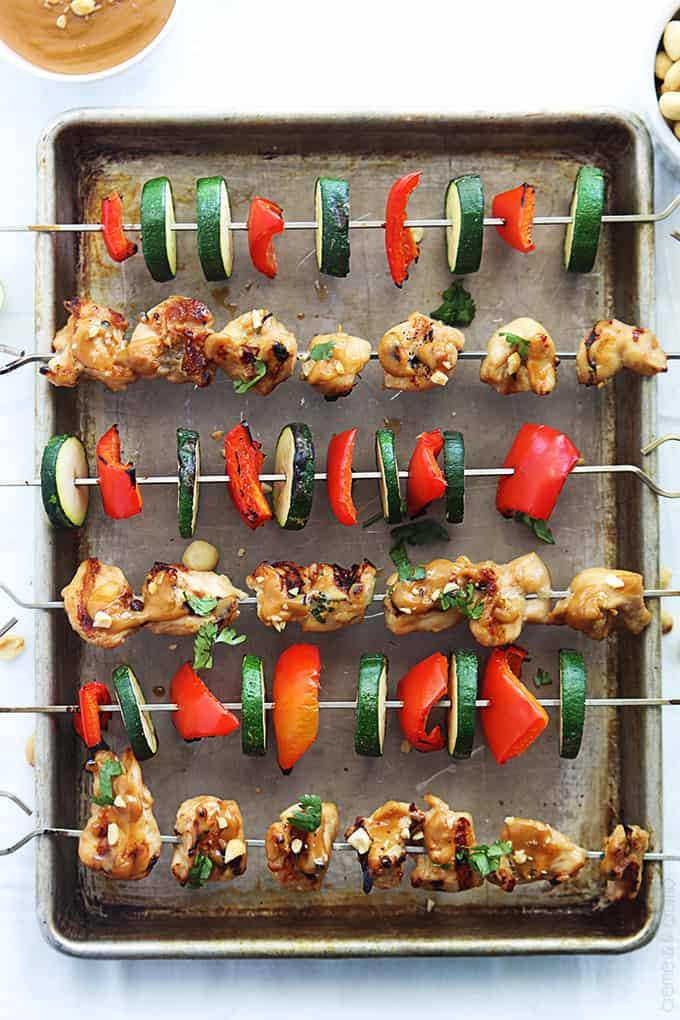 top view of Thai peanut chicken kabobs on a baking sheet.