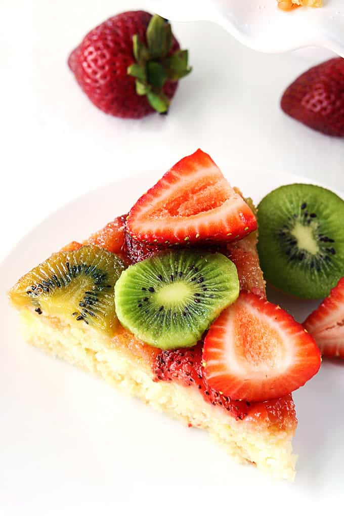 A fluffy and moist white cake with fresh strawberries, kiwis, and an ooey gooey caramel topping! Serve it up warm or chilled for a refreshing summer treat!