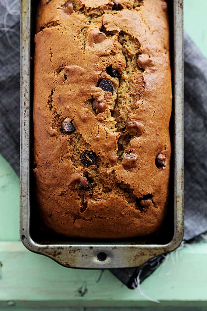 top view of a loaf of browned butter chocolate chip pumpkin bread in a bread pan.