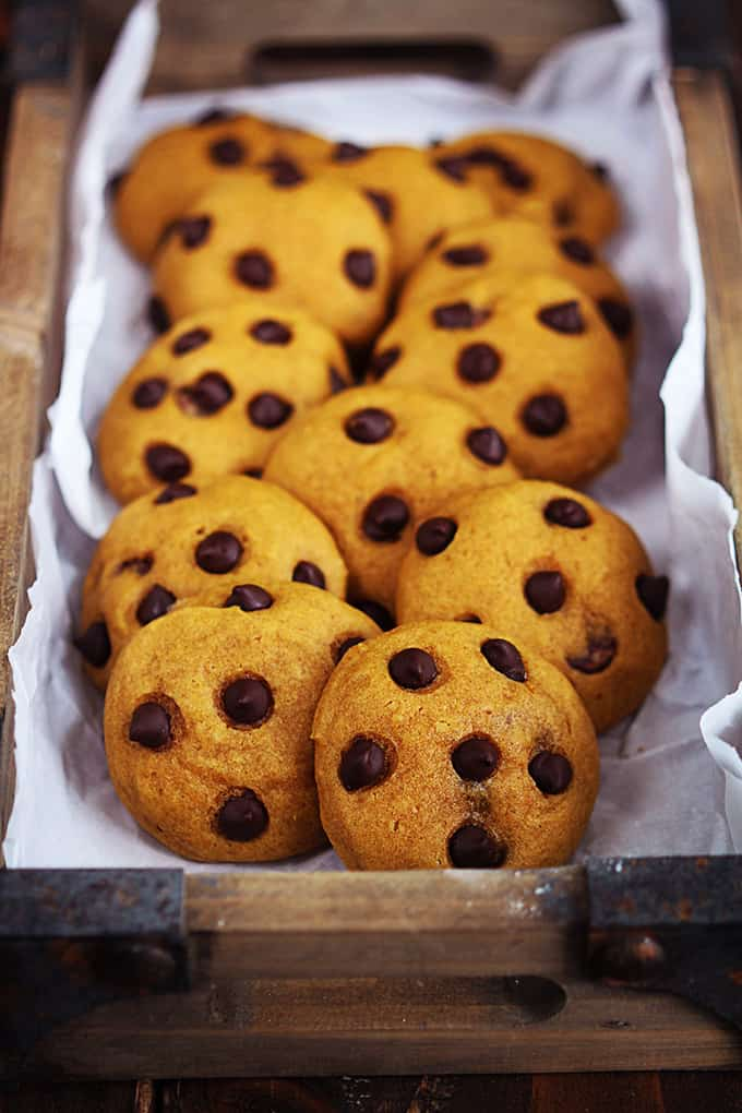 pumpkin chocolate chip cookies in a wooden crate.