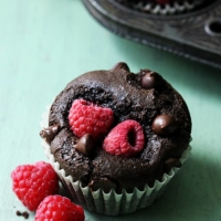 Moist chocolate muffins stuffed with juicy red raspberries!