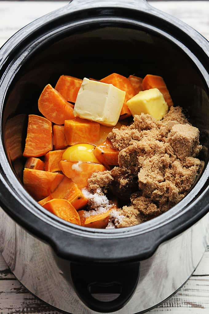 candied pecan sweet potato casserole ingredients uncooked in a slow cooker.