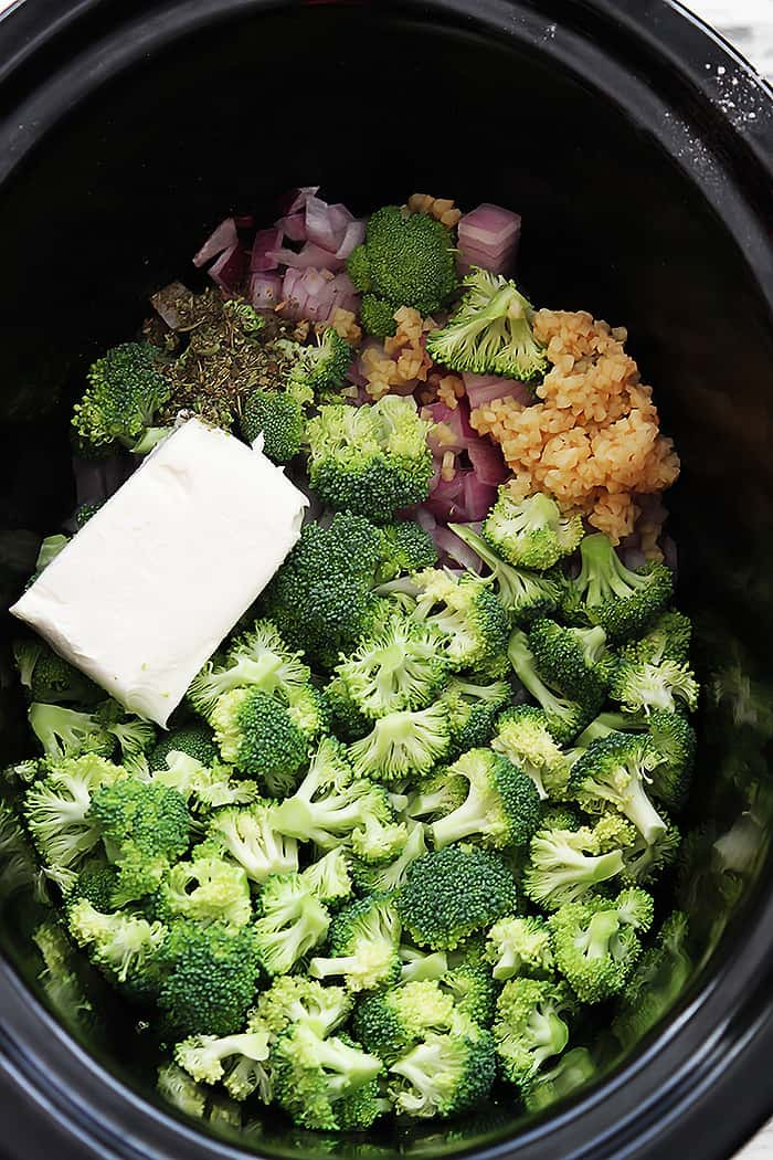 top view of slow cooker broccoli cheese soup ingredients in a slow cooker.