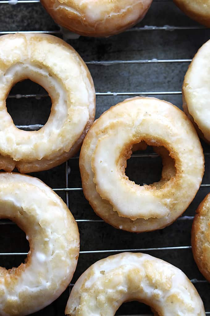 top view of old fashioned sour cream donuts on a cooling rack.