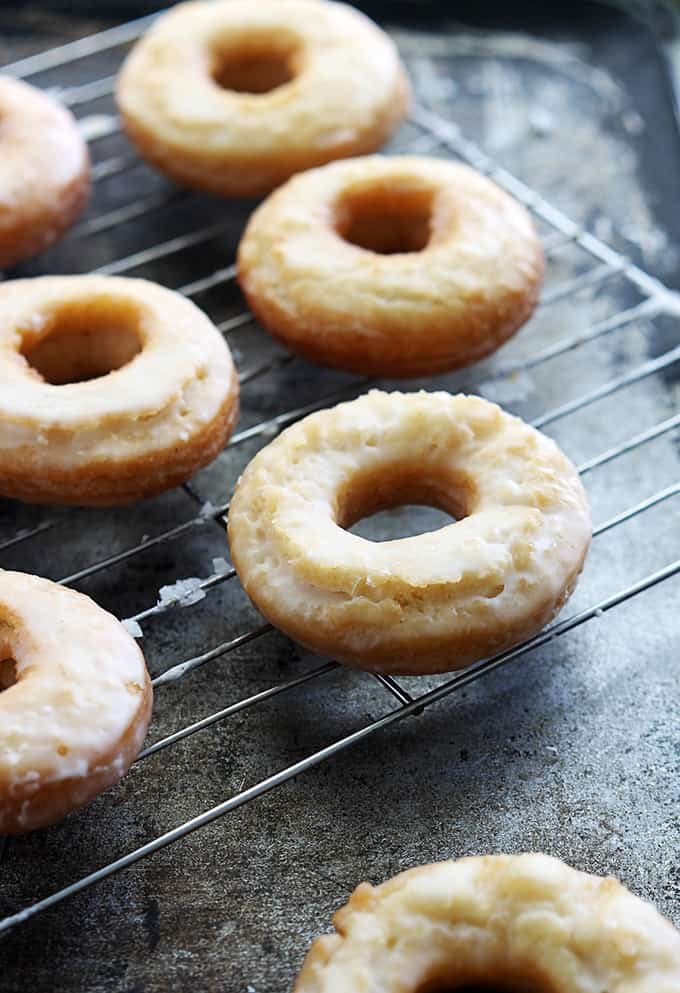 old fashioned sour cream donuts on a cooling rack.