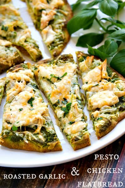 roasted garlic & pesto chicken flatbread on a plate with the title written on the bottom of the image.