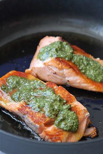 pesto salmon in a skillet.