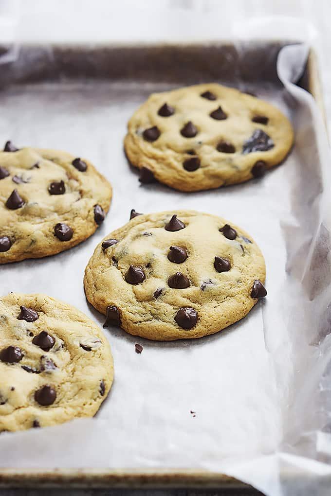 hot fudge stuffed chocolate chip cookies on a baking sheet.