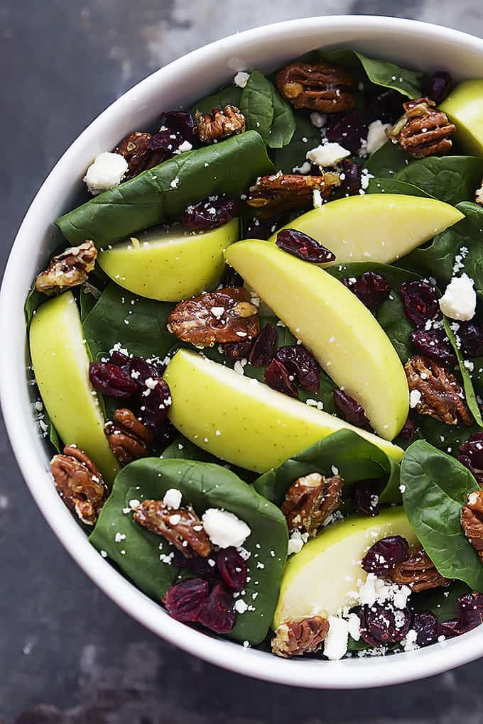 top view of apple cherry candied pecan salad with sweet balsamic dressing in a bowl.