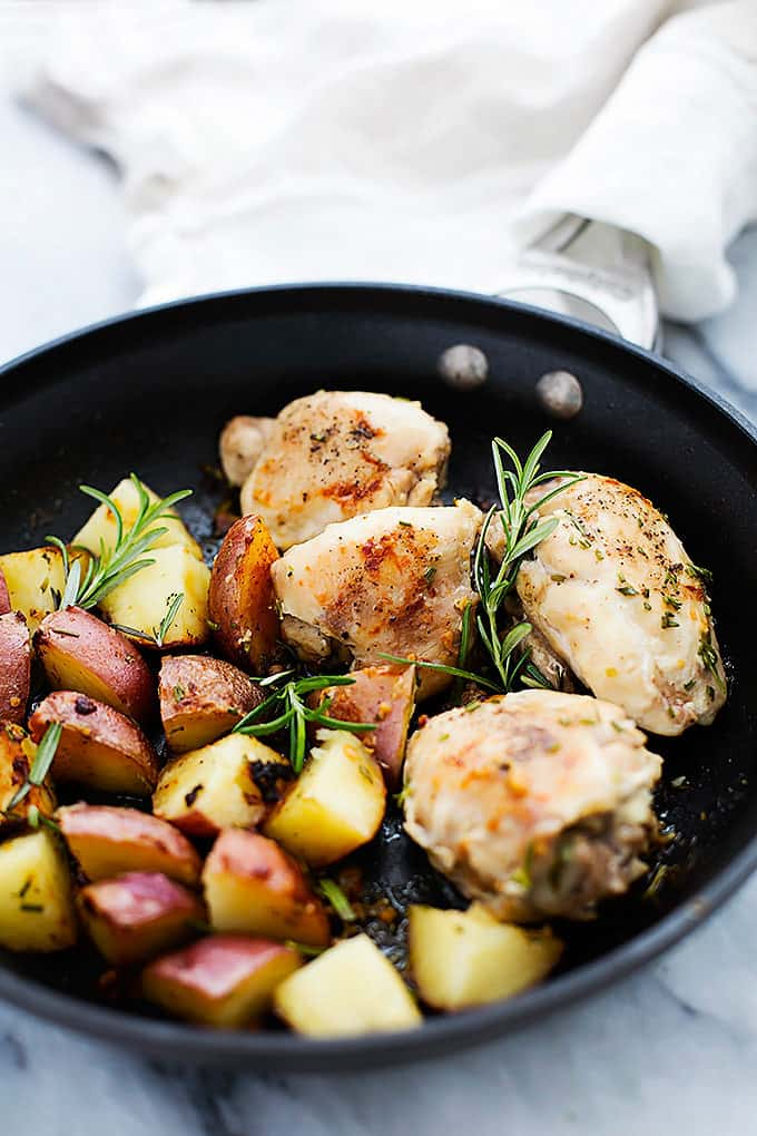 rosemary chicken and potatoes in a skillet.