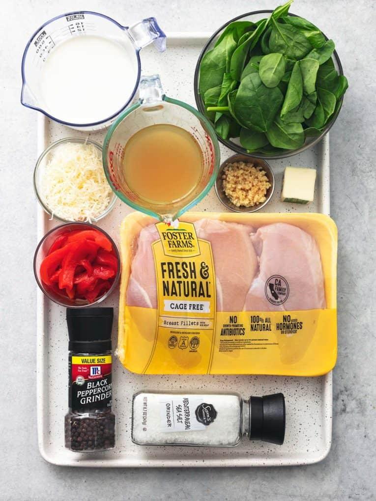 tuscan garlic chicken ingredients on sheet pan