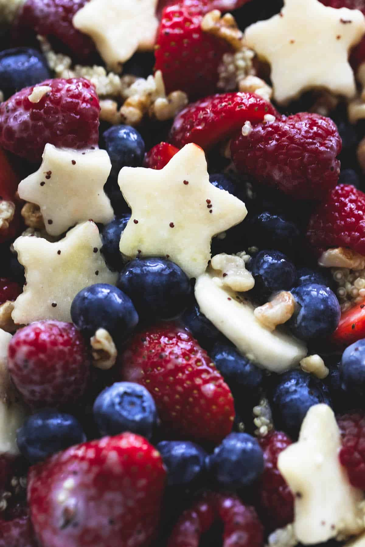 close up of Patriotic fruit salad with honey lime dressing.