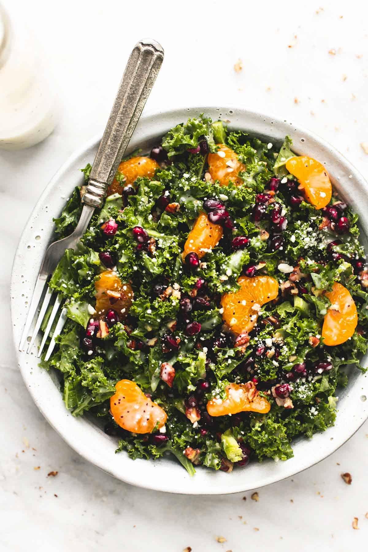 Mandarin Pomegranate Chopped Kale Salad  with Lemony Poppyseed Dressing | lecremedelacrumb.com