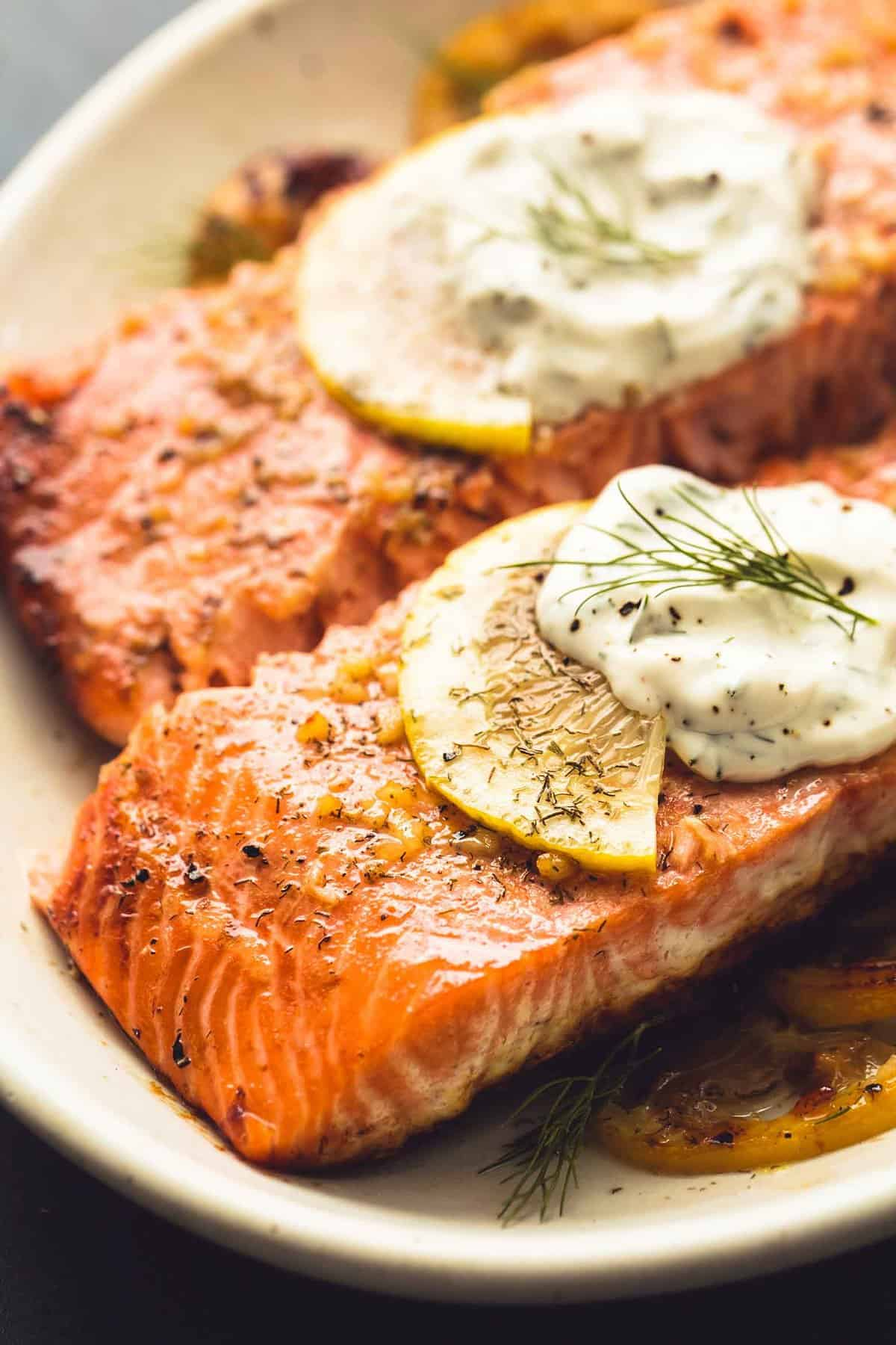 Baked Salmon with Creamy Lemon Dill Sauce | lecremedelacrumb.com