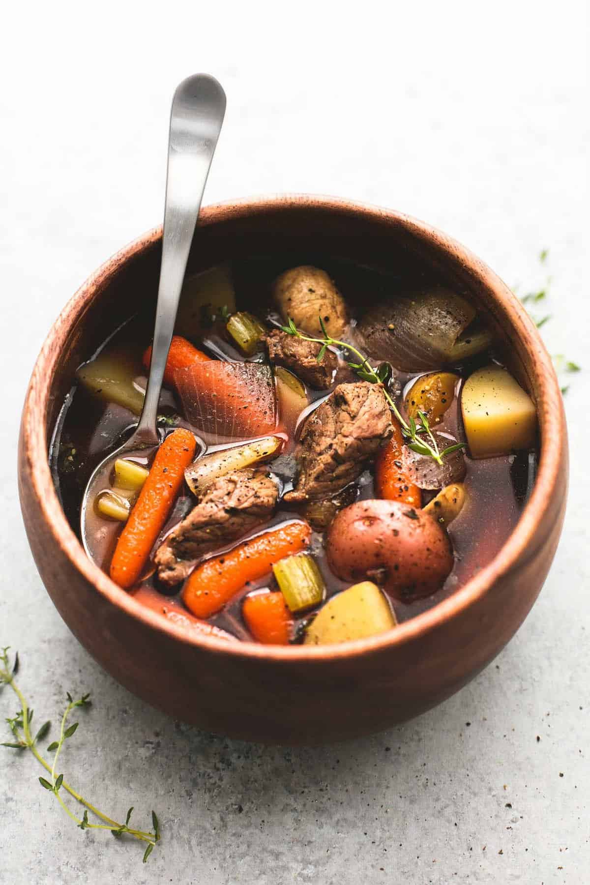 Hearty and flavorful slow cooker beef and potato stew is chock-full of juicy, tender beef and savory vegetables. Let your crockpot do the work and enjoy this tasty dinner with just 10 minutes of prep! | lecremedelacrumb.com