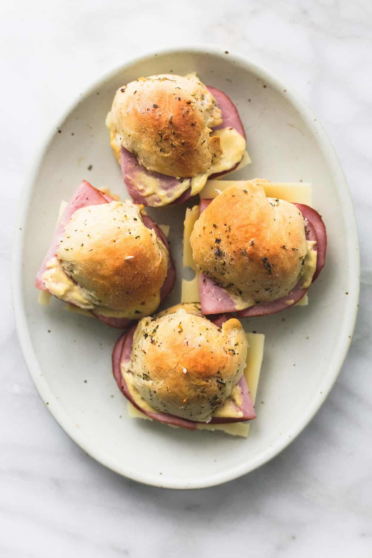 Ham and Cheese Sliders on Buttery Herb Rolls | lecremedelacrumb.com