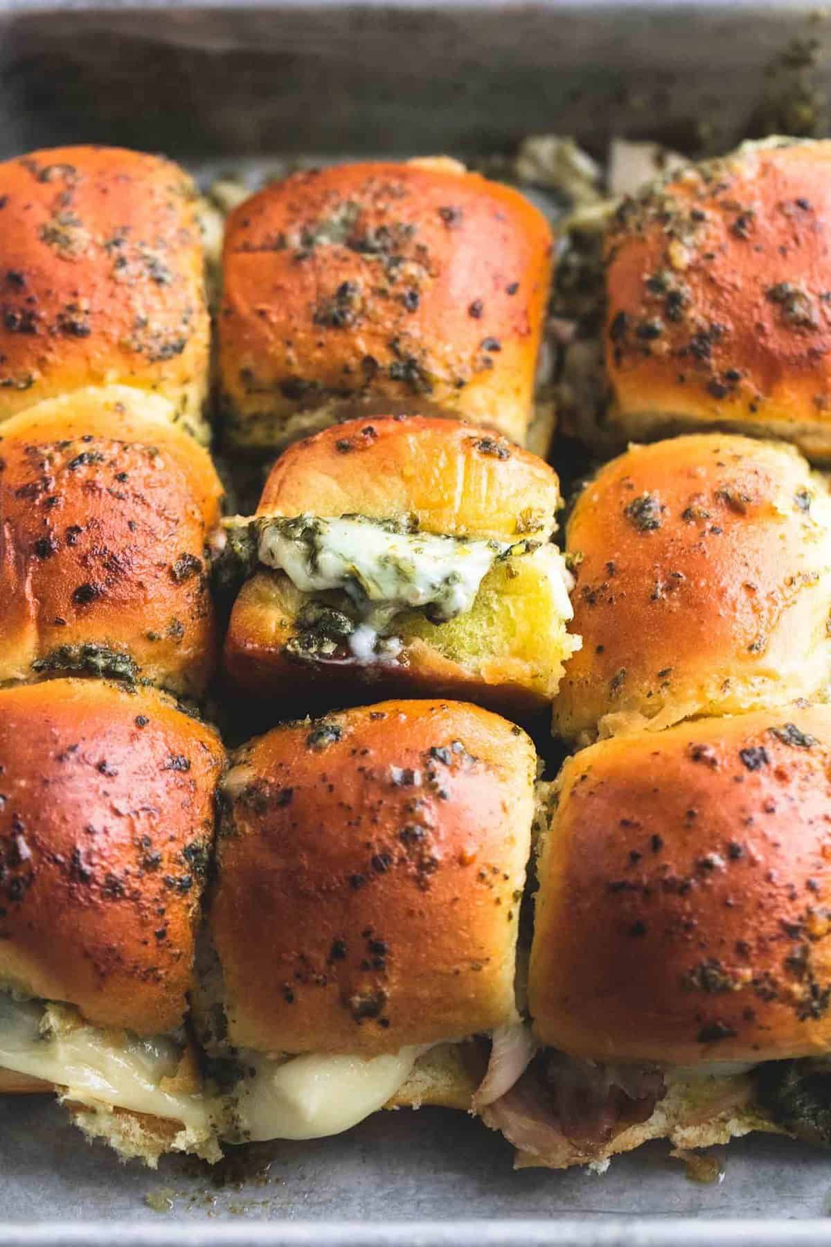 Pesto Mozzarella Chicken Sliders | lecremedelacrumb.com