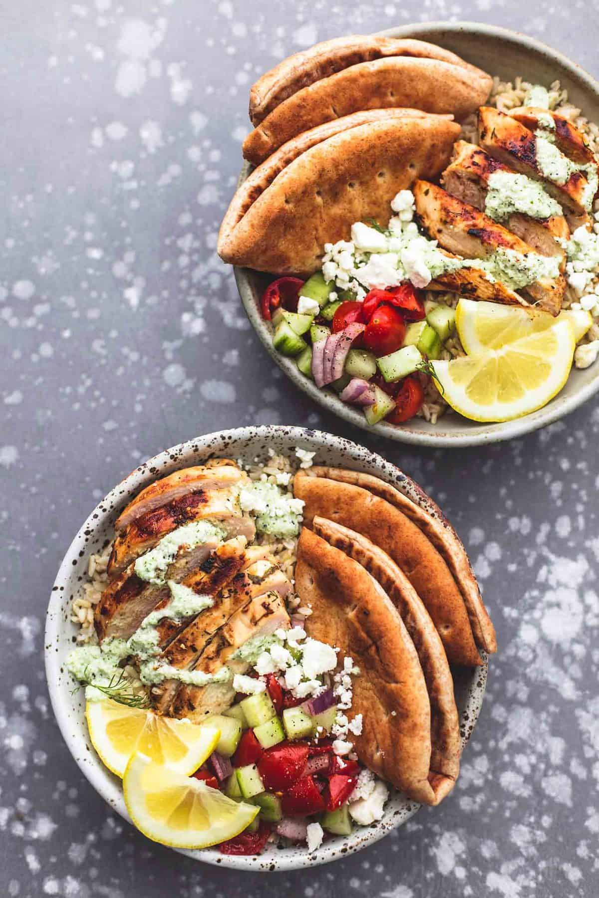 top view of meal prep Greek chicken gyro bowls.