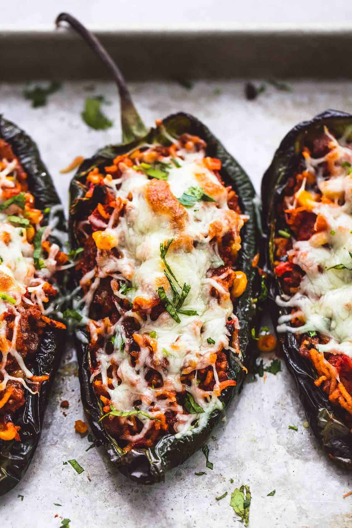 close up of Southwest stuffed poblano peppers on a baking sheet.