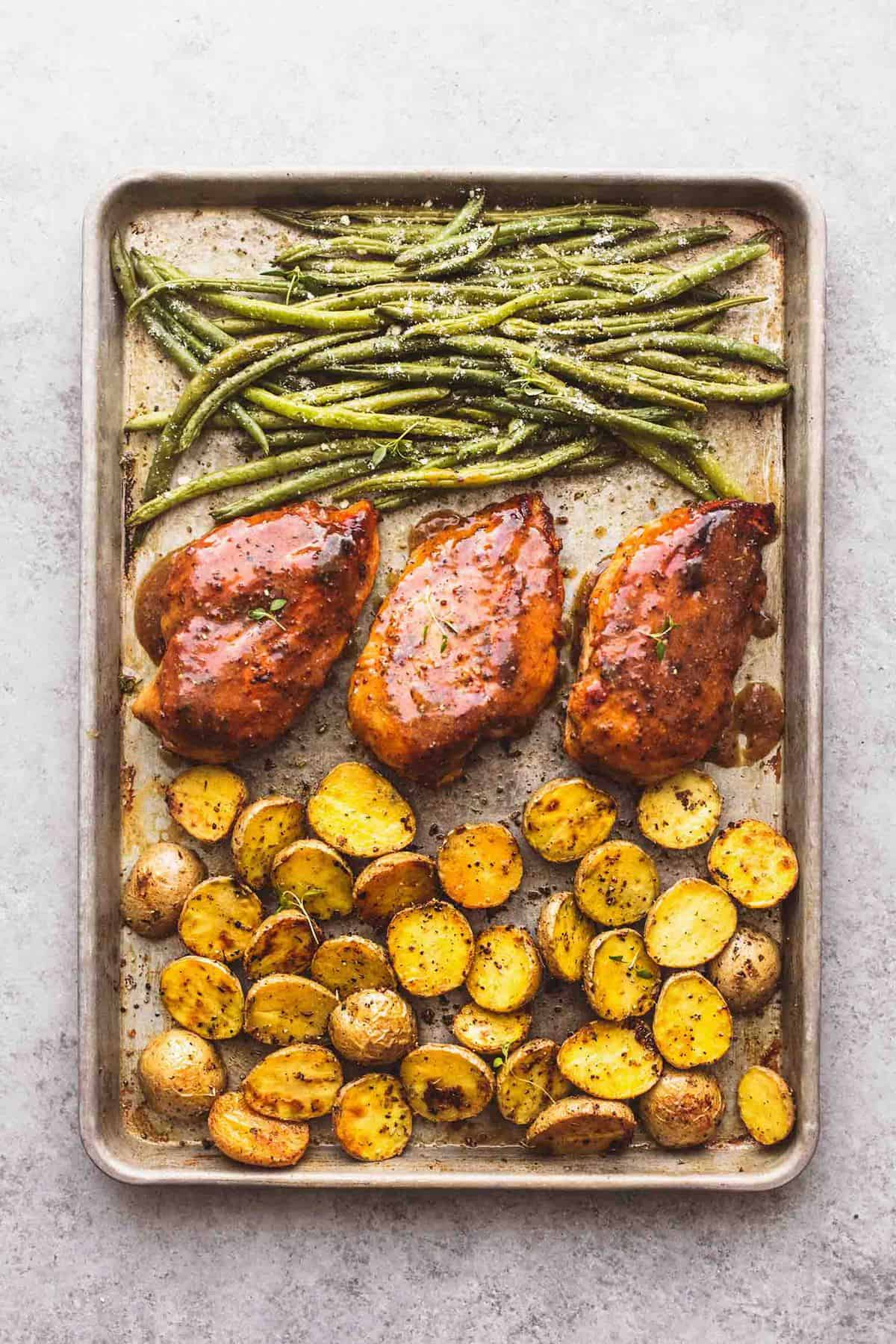 Sheet Pan Chicken Potatoes and Green Beans recipe | lecremedelacrumb.com