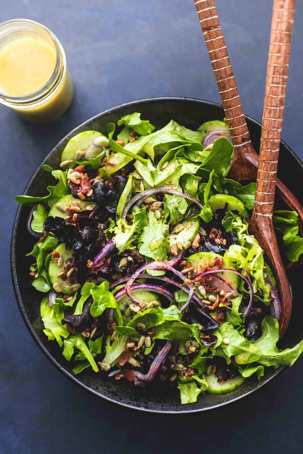 Best Simple Tossed Green Salad is the easiest side dish and goes perfectly with just about anything! Totally customizable and tossed in the tastiest 6-ingredient homemade dressing! | lecremedelacrumb.com