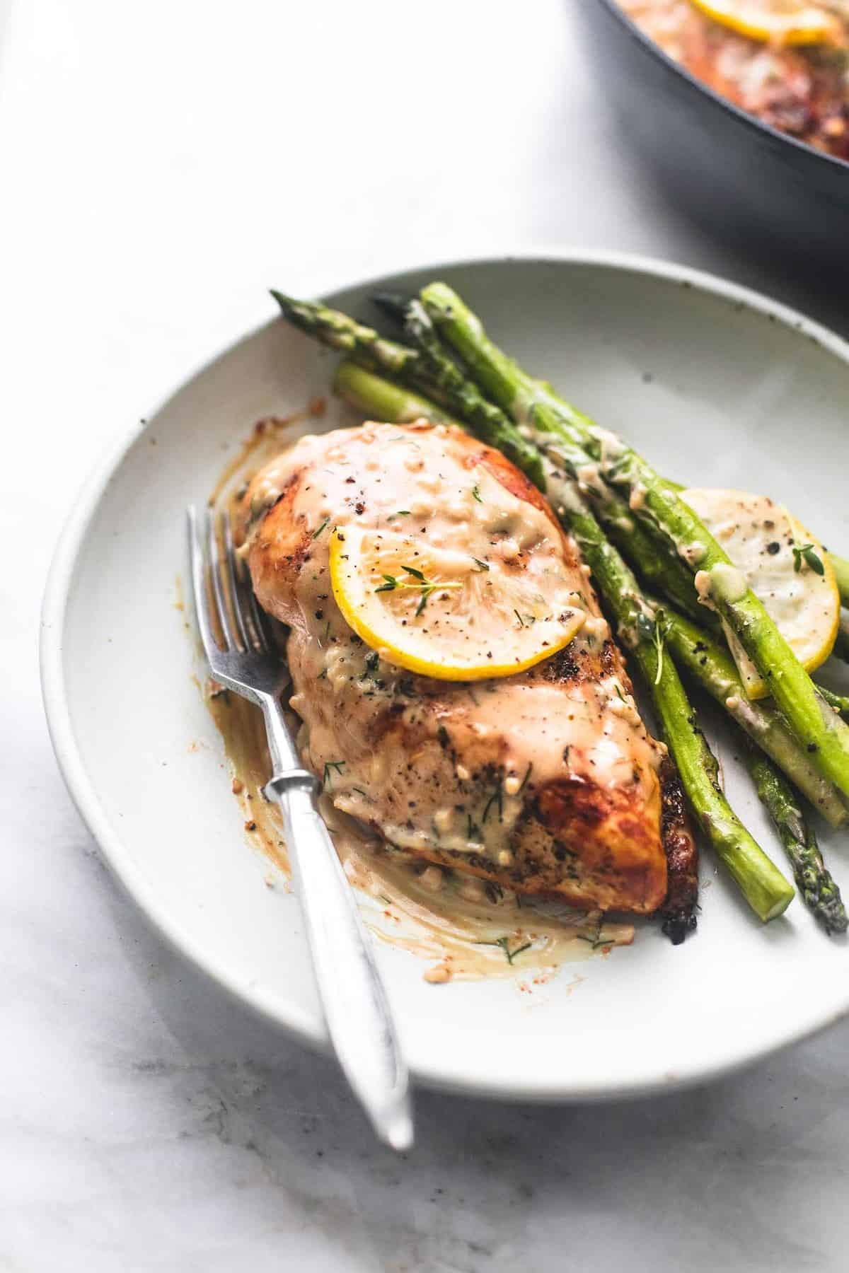 Easy One Pan Creamy Lemon Chicken and Asparagus Dinner Recipe | lecremedelacrumb.com