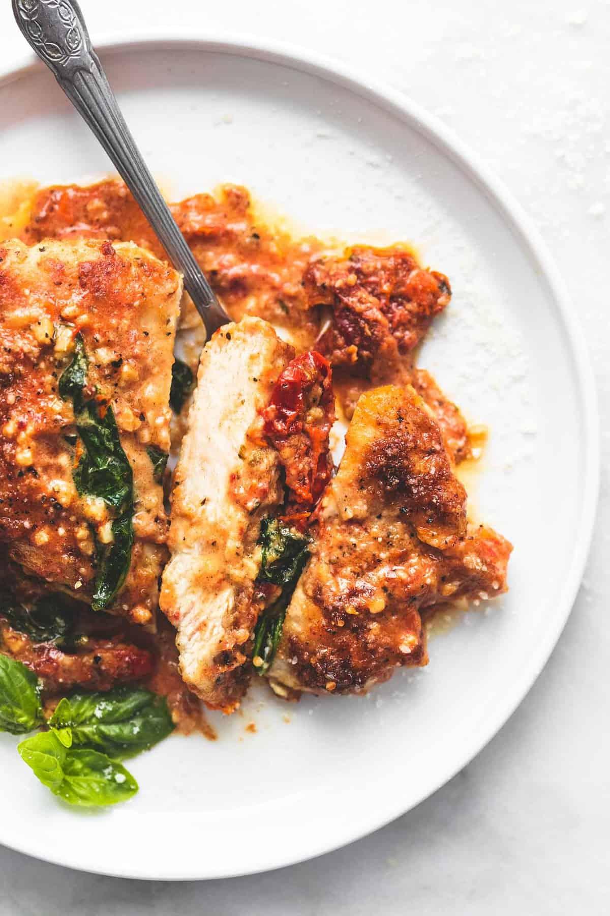 Creamy Tuscan Parmesan Chicken | lecremedelacrumb.com