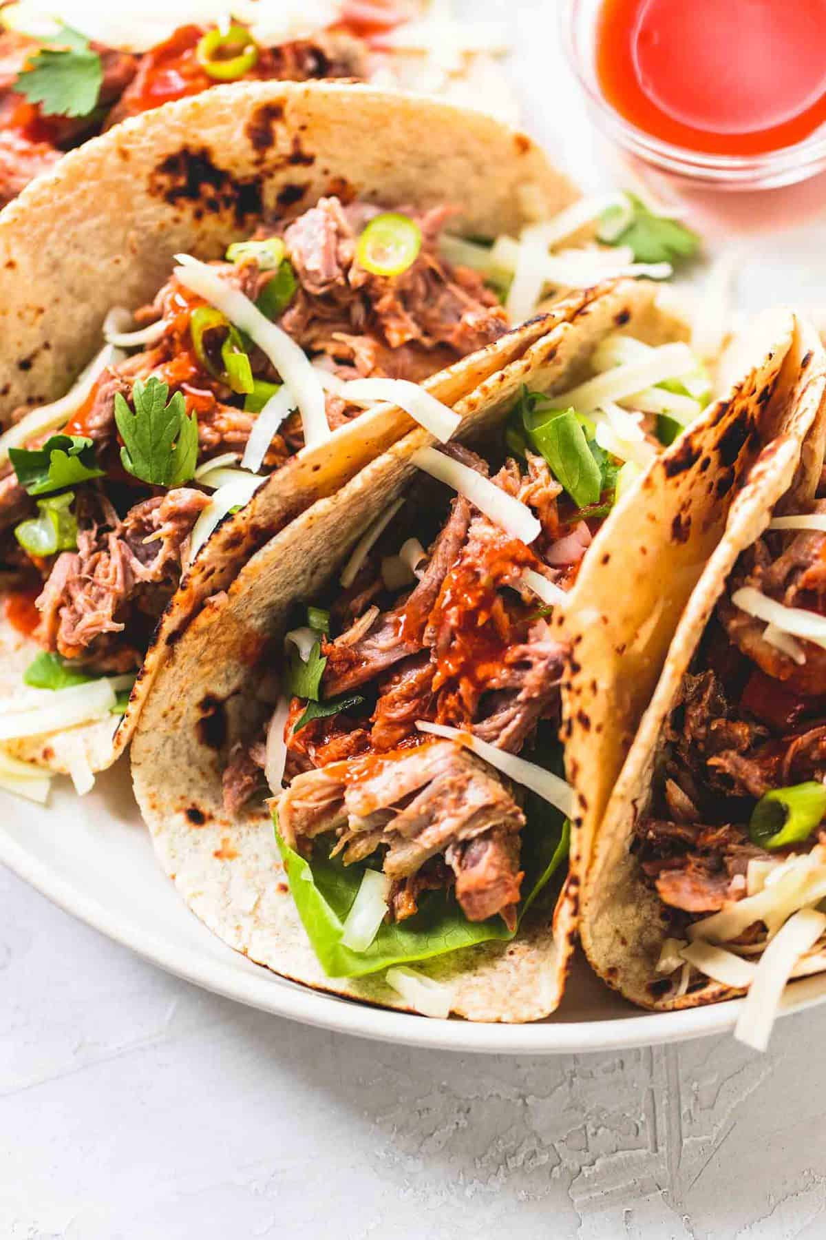 Slow Cooker Pork Tacos easy dinner recipe | lecremedelacrumb.com