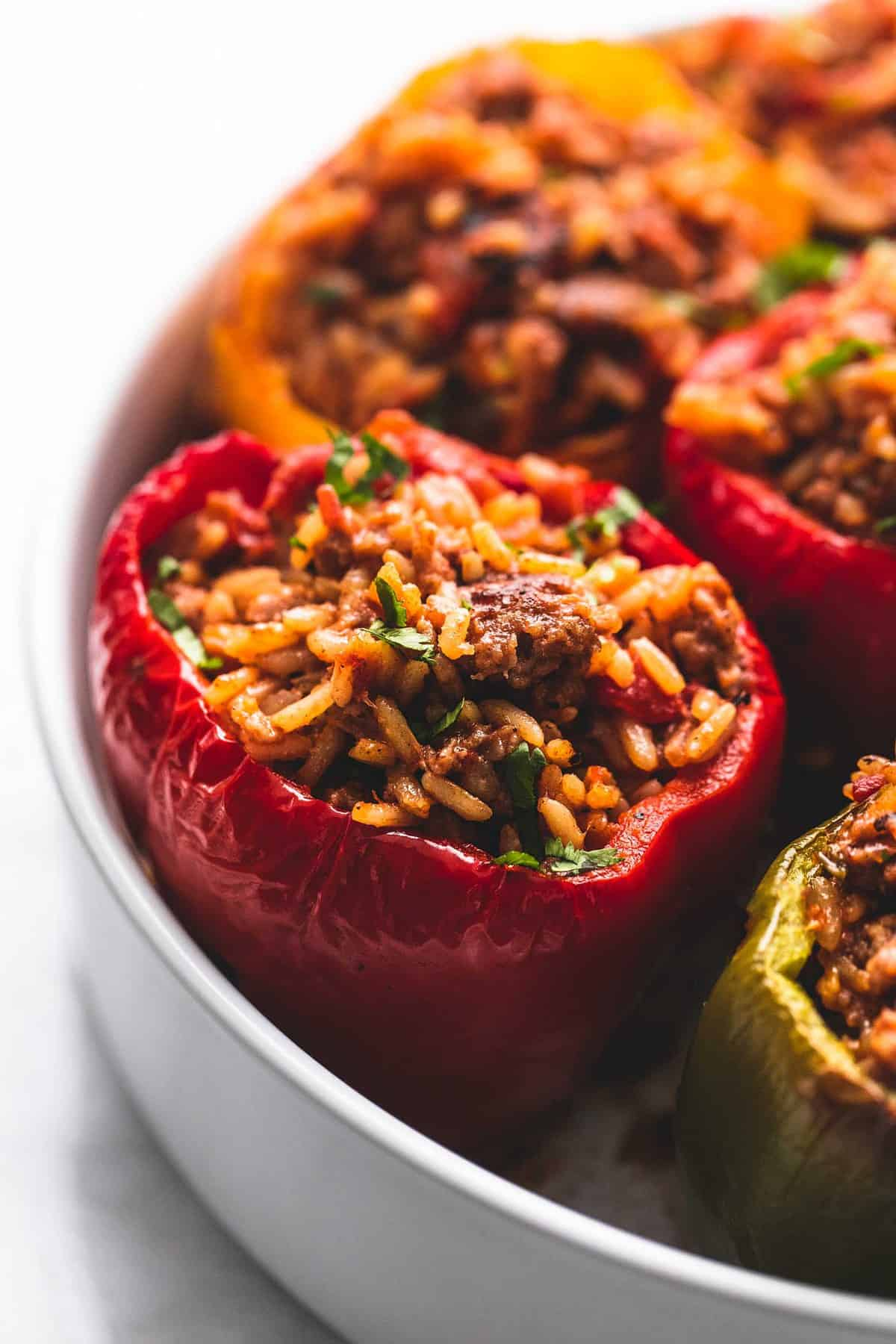 close up of stuffed peppers on a round dish.