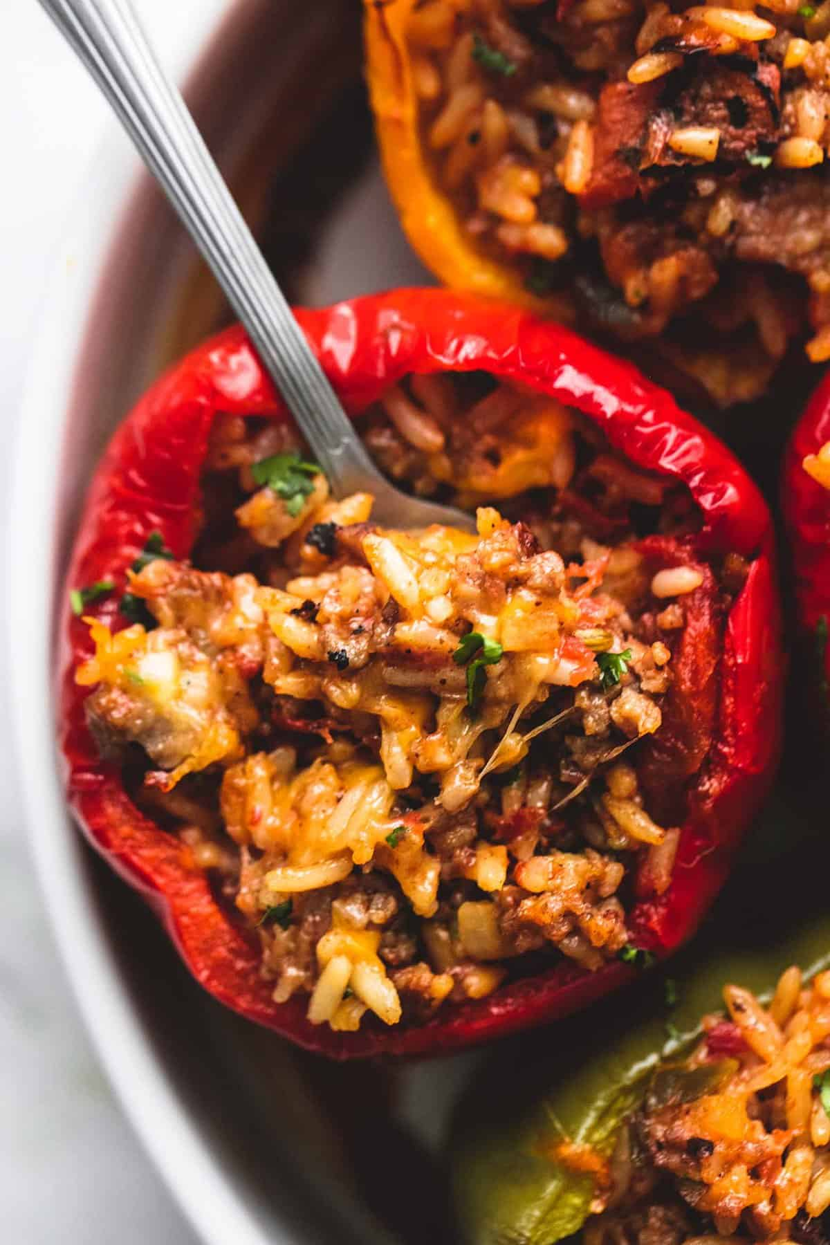 close up top view of a stuffed pepper with a spoon in it.