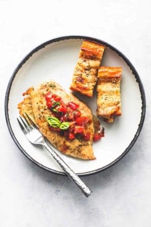 Sheet Pan Bruschetta Chicken and Cheesy Garlic Bread easy one pan dinner recipe | lecremedelacrumb.com
