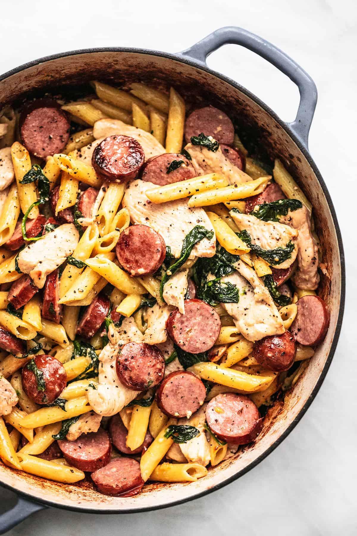 Easy Chicken and Sausage Pasta recipe | lecremedelacrumb.com
