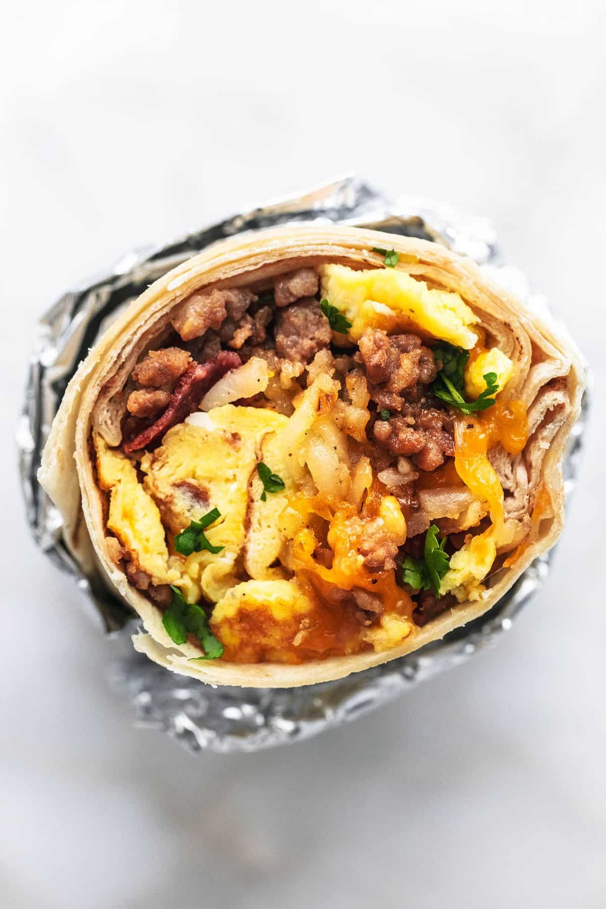 Easy make ahead egg and sausage Freezer Breakfast Burritos Recipe | lecremedelacrumb.com