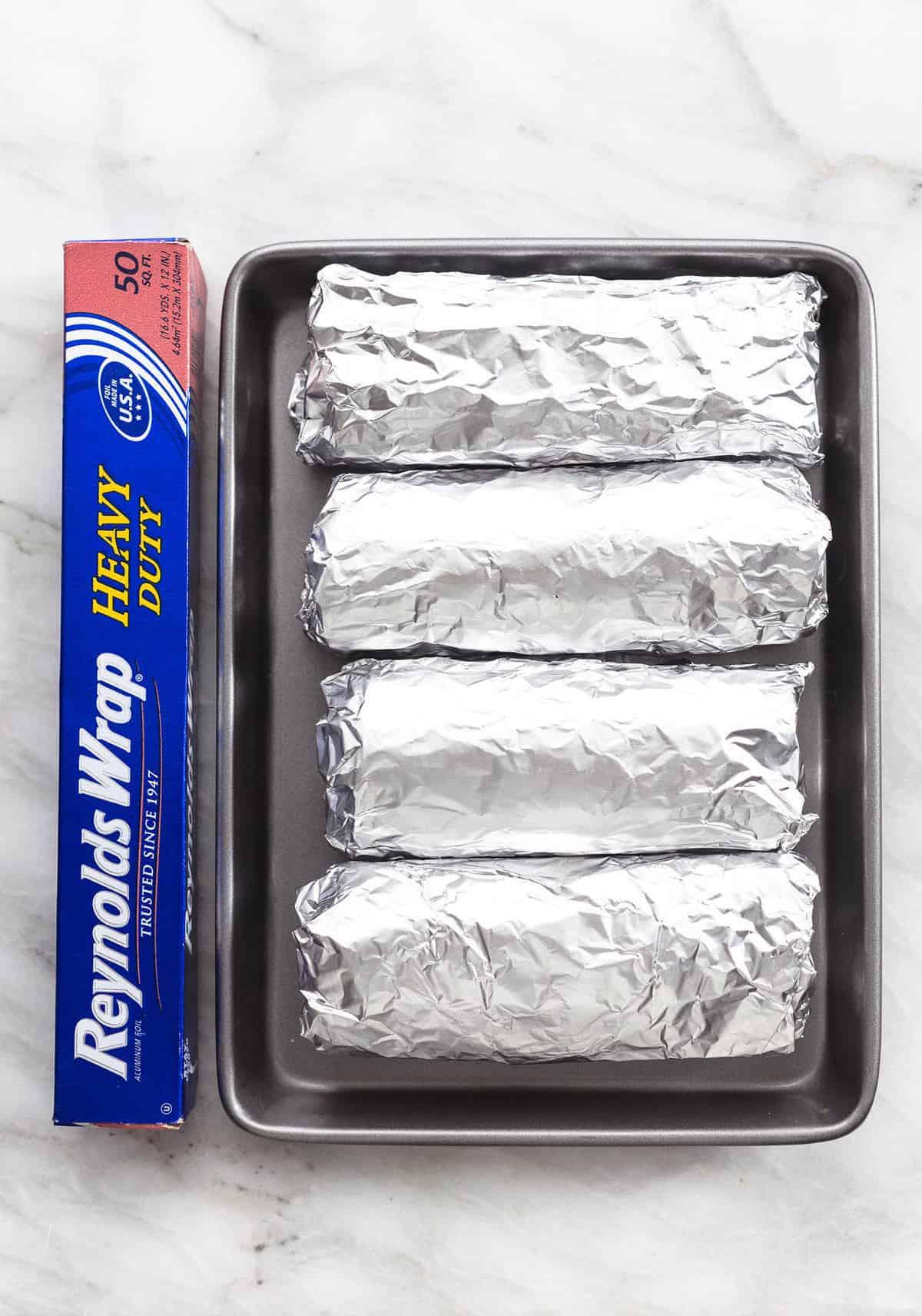 Easy make ahead egg and sausage Freezer Breakfast Burritos Recipe    lecremedelacrumb.com