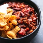 Best ever easy INSTANT POT BEEF CHILI with ground beef, fire roasted tomatoes, and tons of flavor!   lecremedelacrumb.com