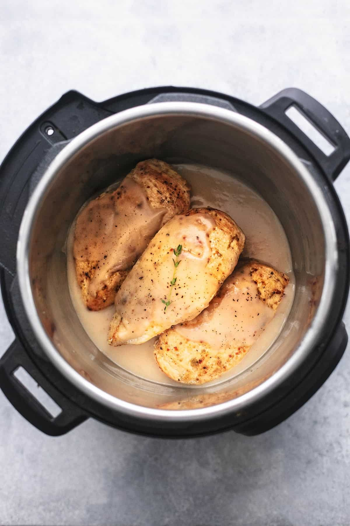 top view of instant pot chicken breast and gravy in an instant pot.
