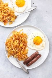 Easy, one pan SHEET PAN BREAKFAST with crispy hashbrowns, eggs, and sausage. | lecremedelacrumb.com