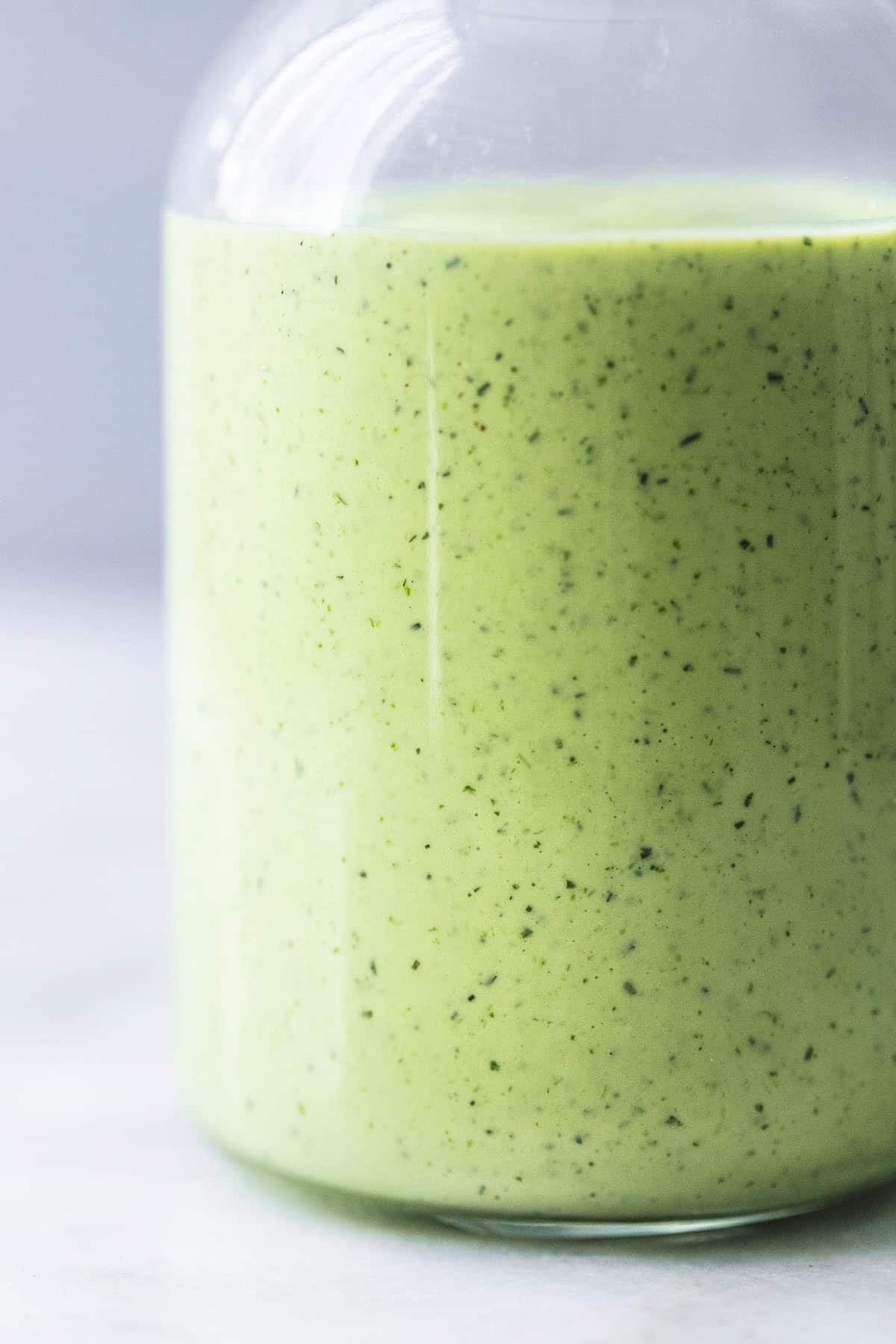 healthy cilantro avocado ranch dressing up close in a bottle