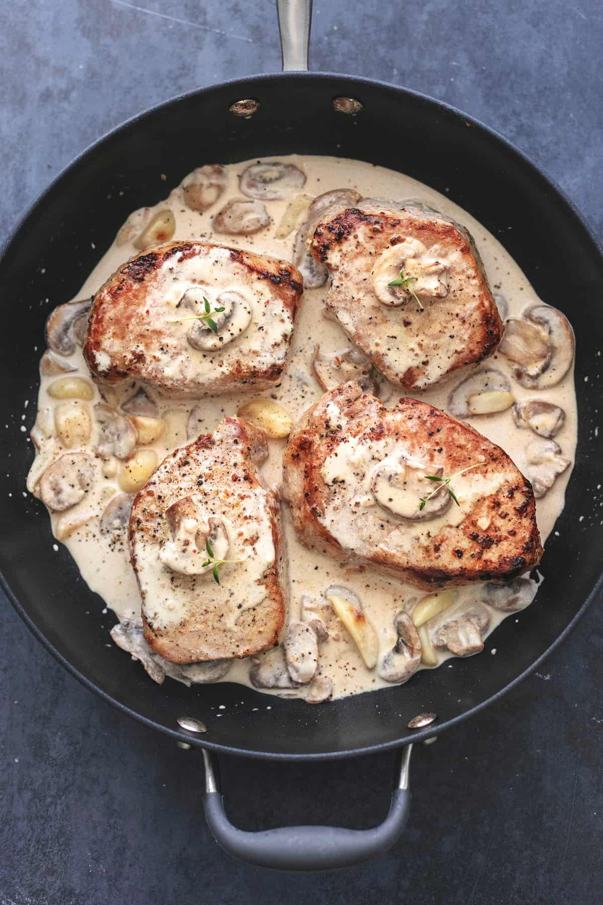 Pork Chops with Creamy Mushroom Sauce easy dinner recipe | lecremedelacrumb.com